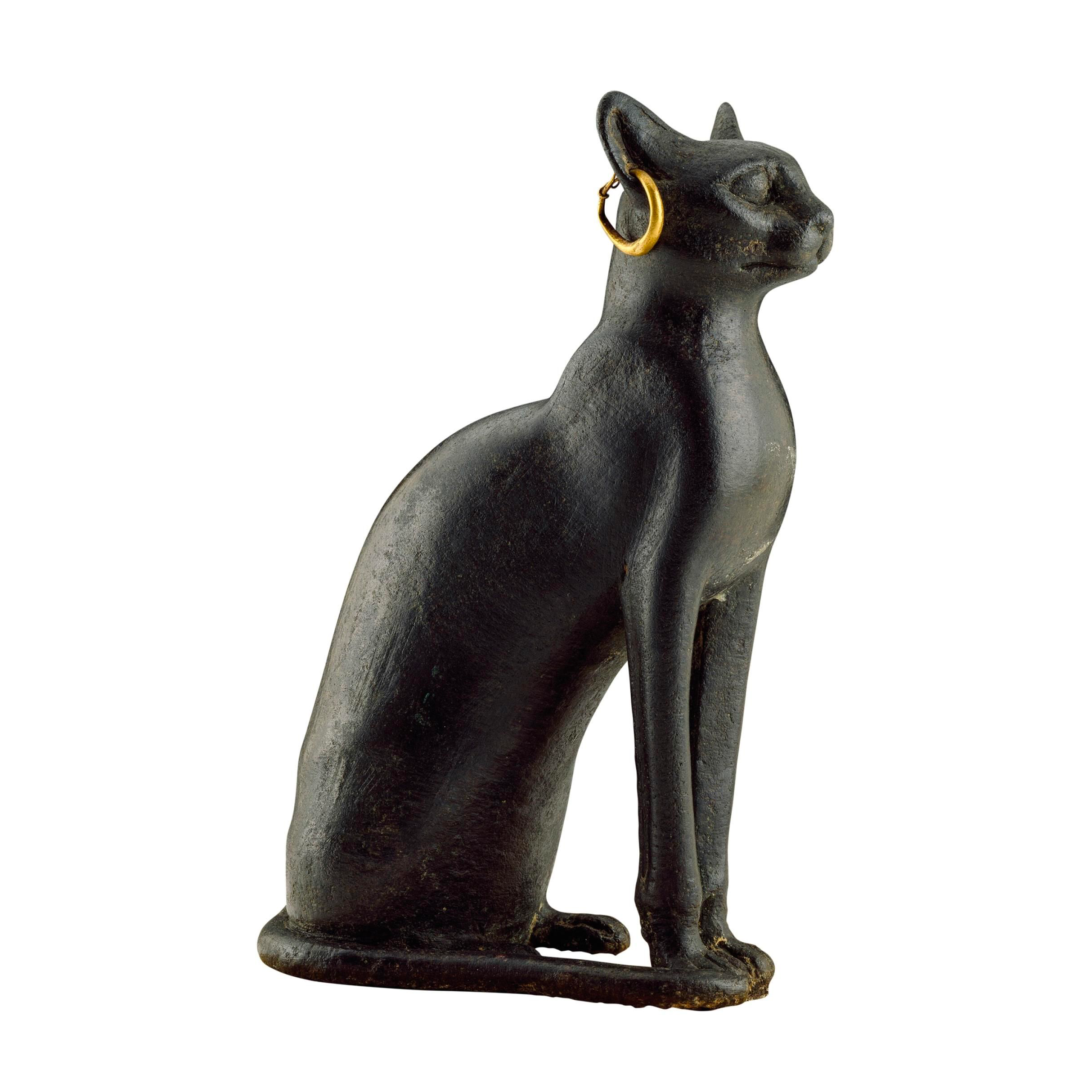 Copper statue of the cat goddess Bastet. Eighth to fourth centuries B.C. PHOTOGRAPH BY MARY EVANS/SCALA, FLORENCE